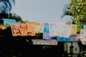 multicolored papel picado at a fiesta theme party