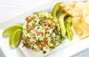 Ceviche on a plate with avocado